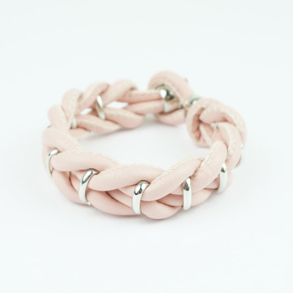 Leather look pink weave bracelet with crystals