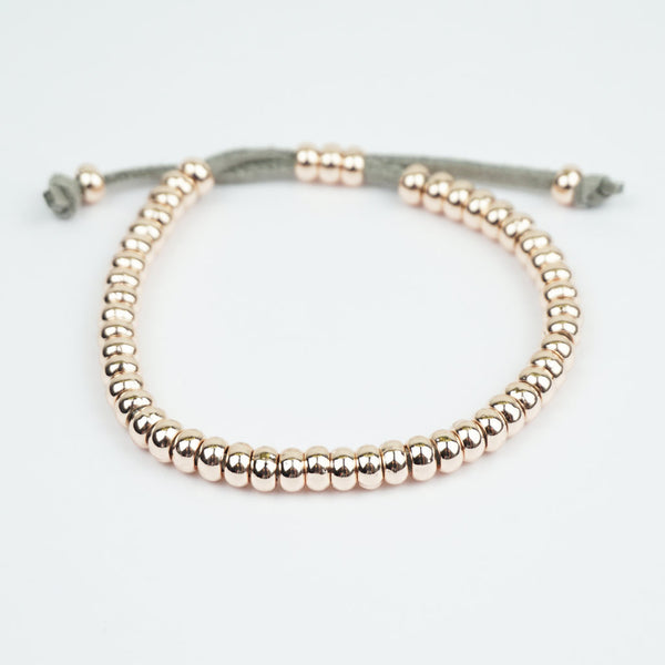Rose gold beaded bracelet suede adjustable strap