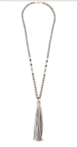 Gray beaded necklace with leather tassel
