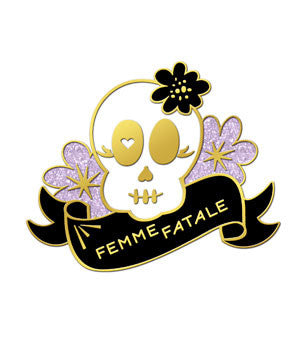 "Enamel pin of a kawaii skull surrounded by flowers and a ribbon that says ""Femme Fatale""."