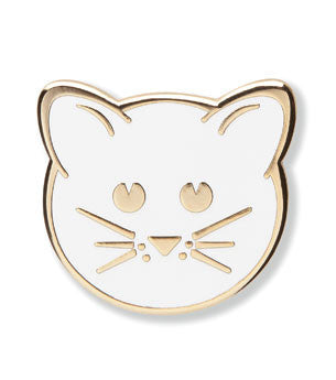 Enamel pin of a kitten face in white and gold.
