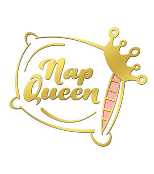 "Enamel pin of a gold and white pillow with a crown perched on the corner and the words ""Nap Queen"" in the center of the pillow."