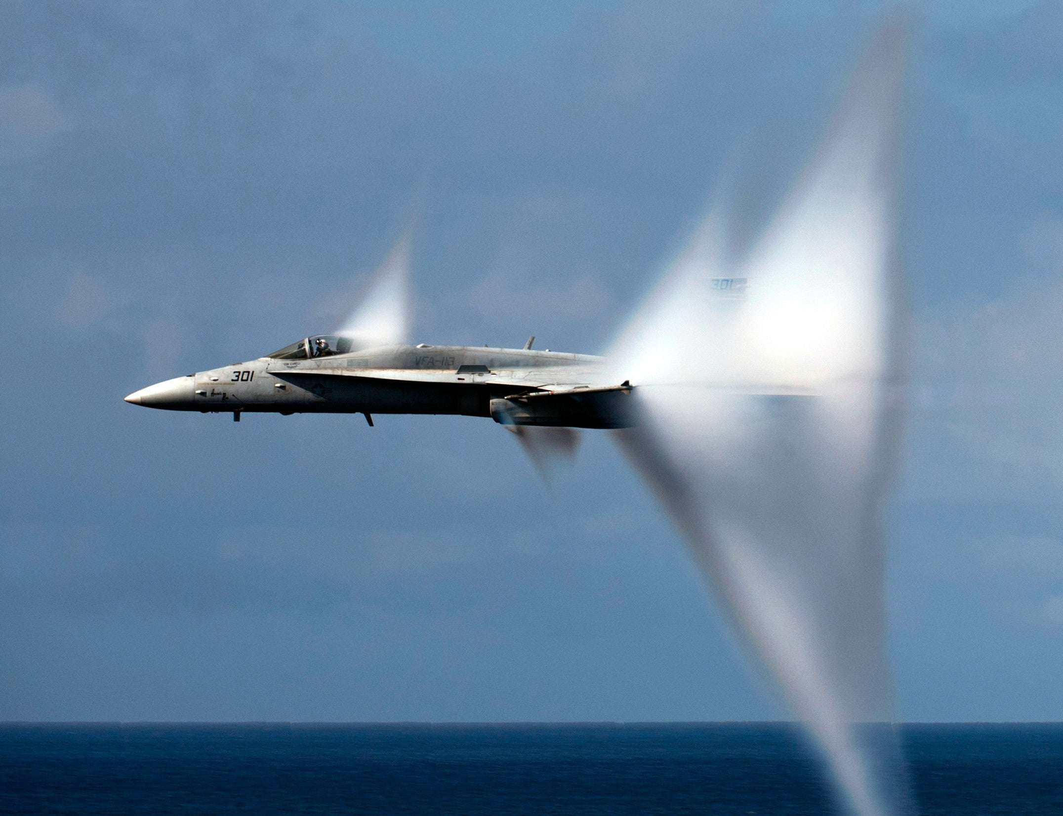 "F/A-18C Hornet Assigned to Strike Fighter Squadron (VFA) 113 Breaks the Sound Barrier June 6, 2011 - 8 x 10"" Photograph"