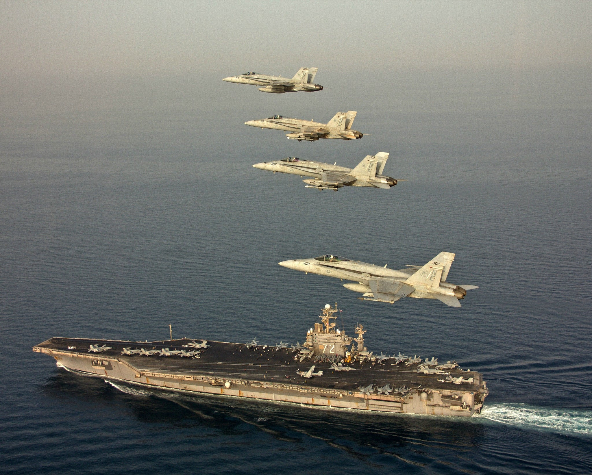 "F/A-18C Hornets Vigilantes of Strike Fighter Squadron (VFA) 151 USS Abraham Lincoln CVN-72 Arabian Sea March 20, 2012 - 8 x 10"" Photograph"