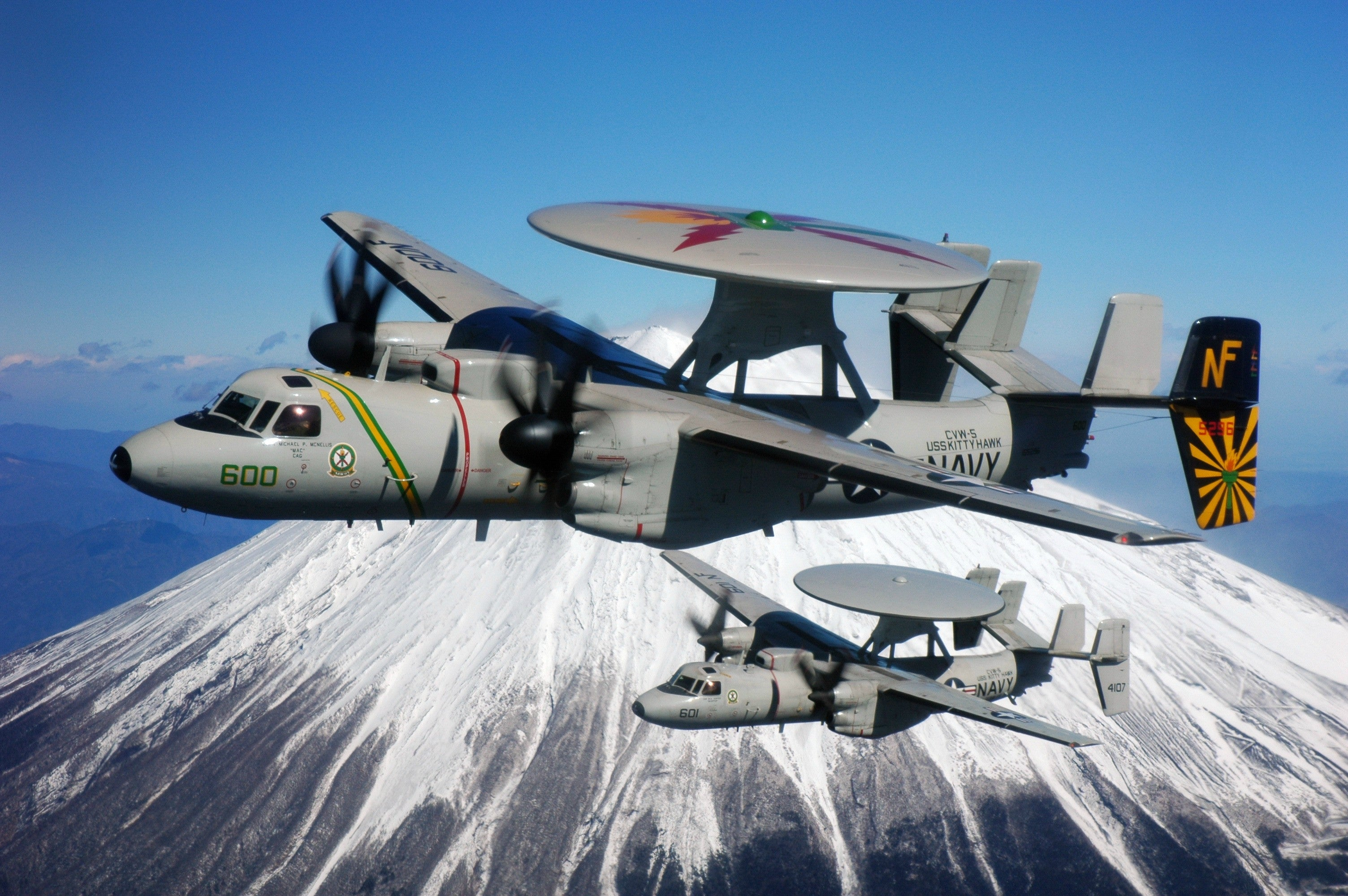 "Two E-2C Hawkeyes Assigned to the Liberty Bells of Carrier Airborne Early Warning Squadron (VAW) 115 off Mt. Fuji Feb. 17, 2007 - 8 x 12"" Photograph"
