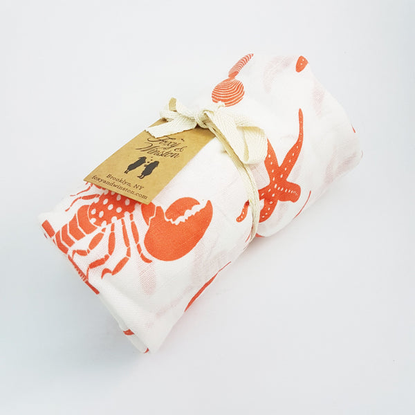 Organic Cotton Muslin Swaddle in Coral Crustacean