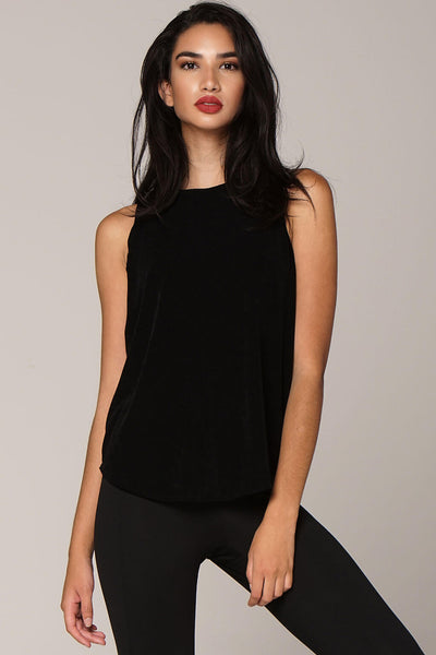 Front view yogavated Luna Evening tank top in black with low back scoop revealing neck to mid back