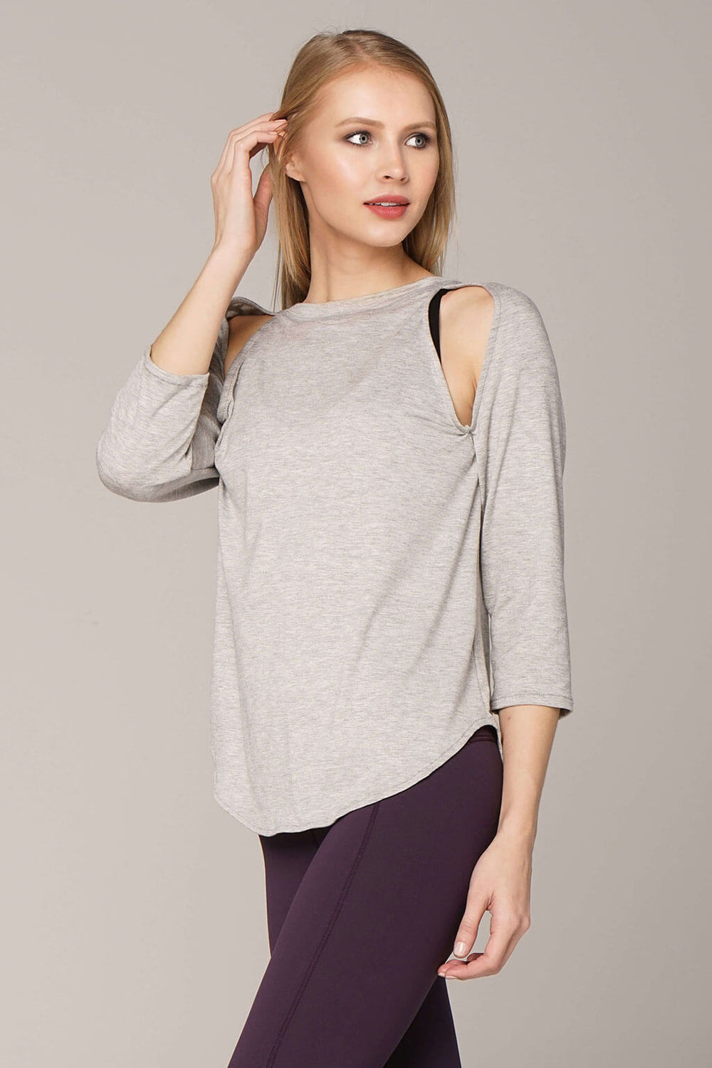 Side view of epidote B-line raglan in grey with art stripe down back and