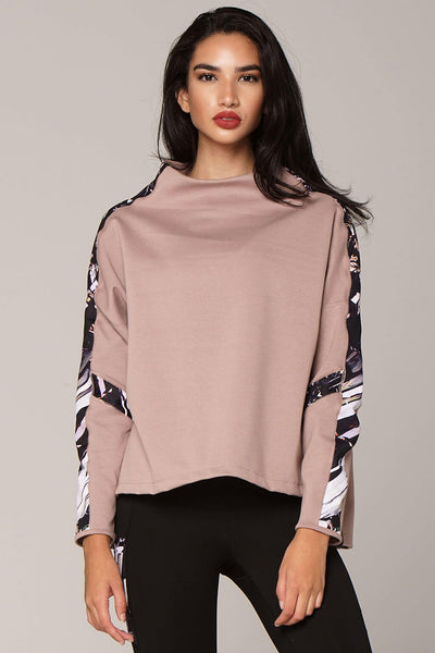 Front view of epidote divine pull-over in champagne with art on sleeves