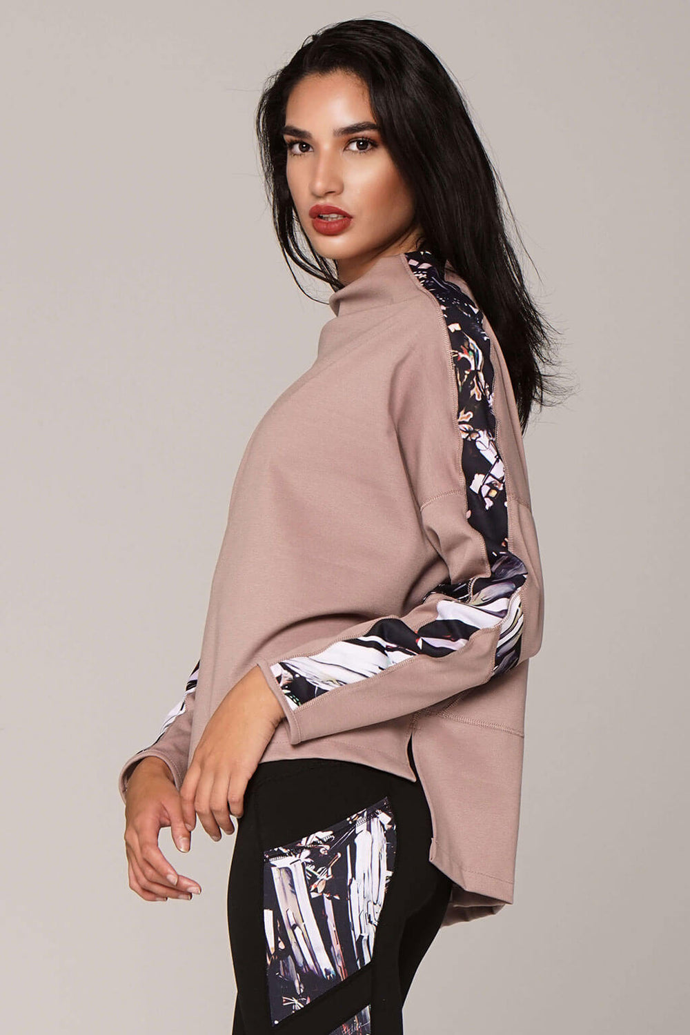 Side view of epidote divine pull-over in champagne with art on sleeves