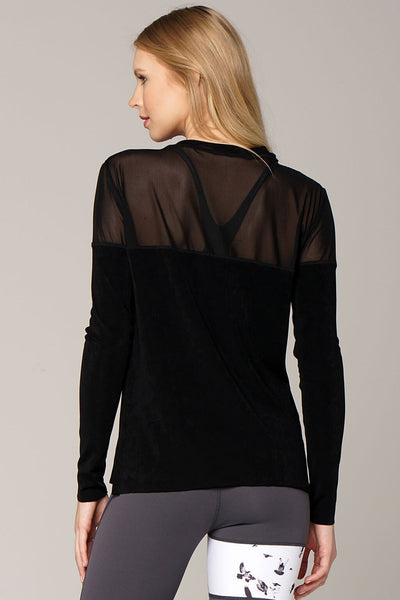 Back view yogavated mirage long sleeve top in black