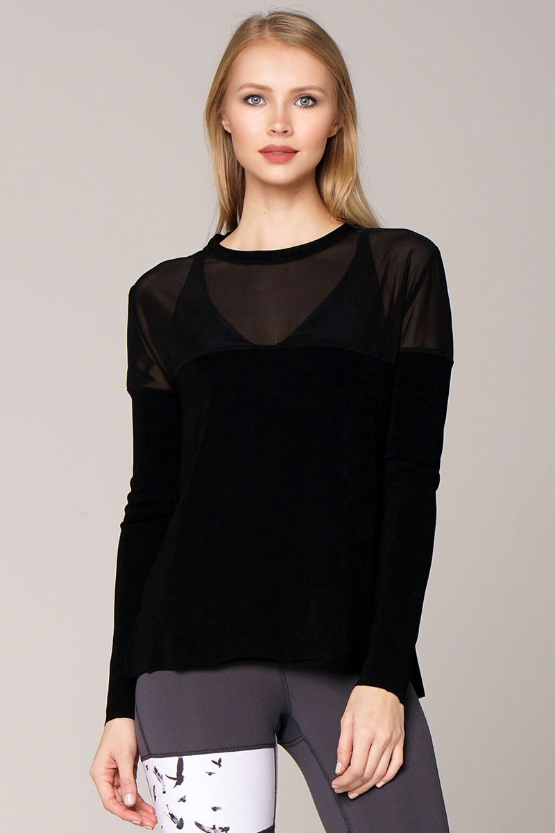 Front view yogavated mirage long sleeve top in black paired with Balance right leggings