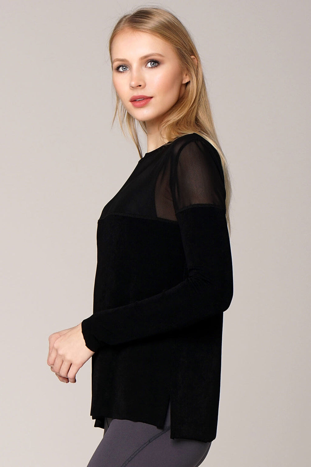Side view yogavated mirage long sleeve top in black
