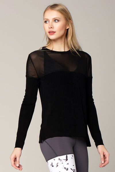 Front view yogavated mirage long sleeve top in black