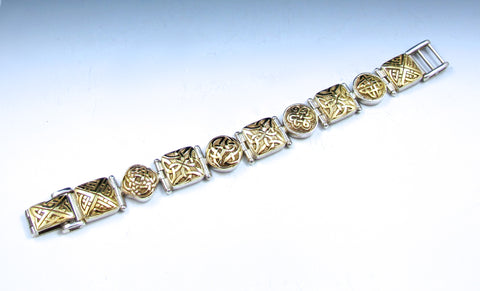Gold eternity knot set in sterling silver bracelet