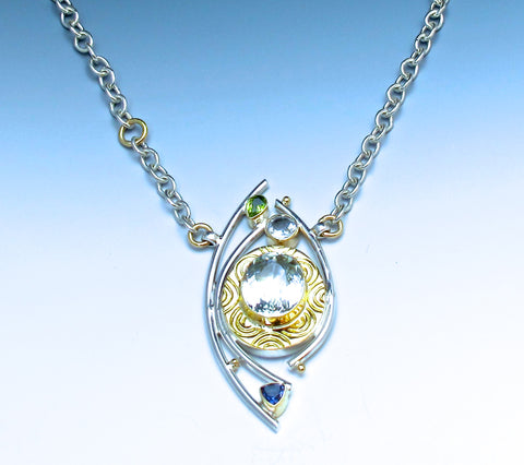 One of A Kind 18k etched gold surrounds white topaz on chain