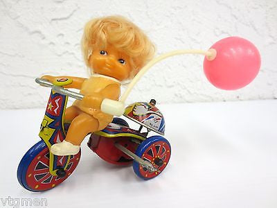 Vintage Mid Century Wind-Up Toy, Blond Girl Riding a Tricycle with Pink Balloon