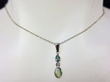 14 White Gold Pendant Set with a VS1 G Diamond and 2 Alexandrites