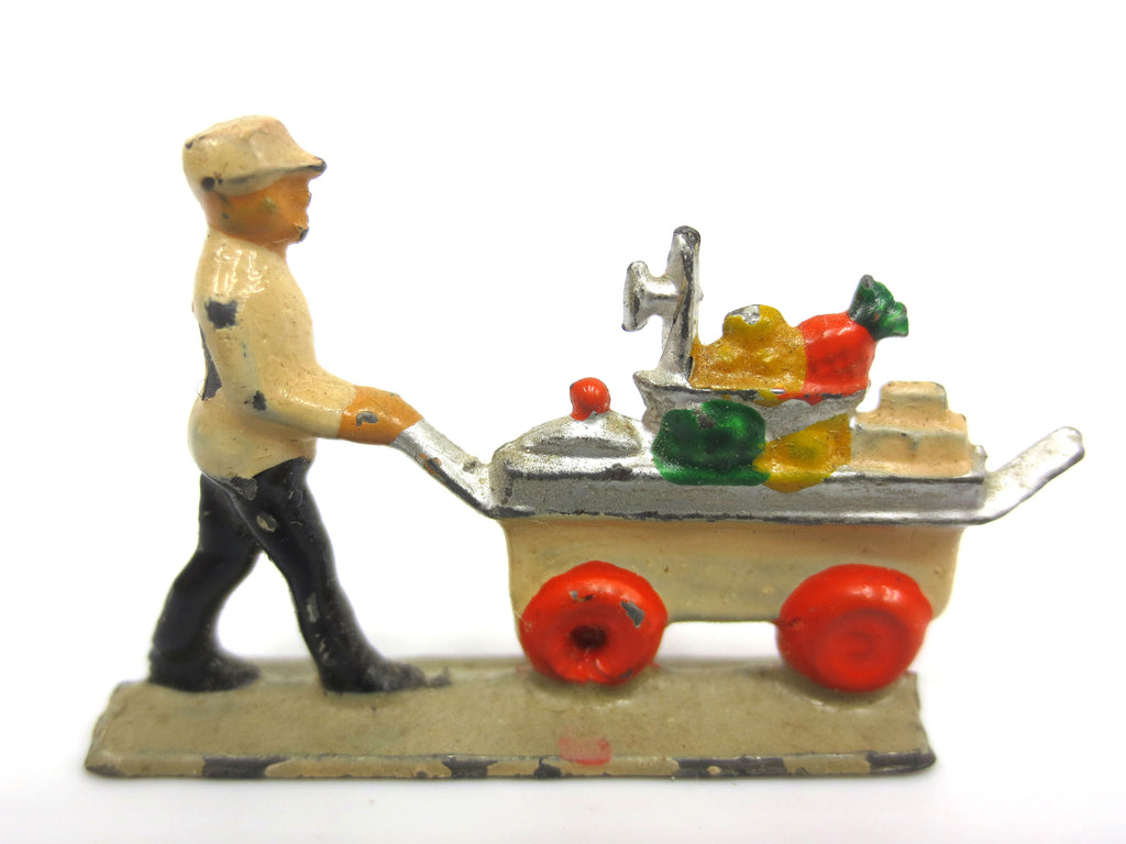 Vintage Miniature Lead Figurine, Caterer in Uniform Pushing Cart Fruits Desserts