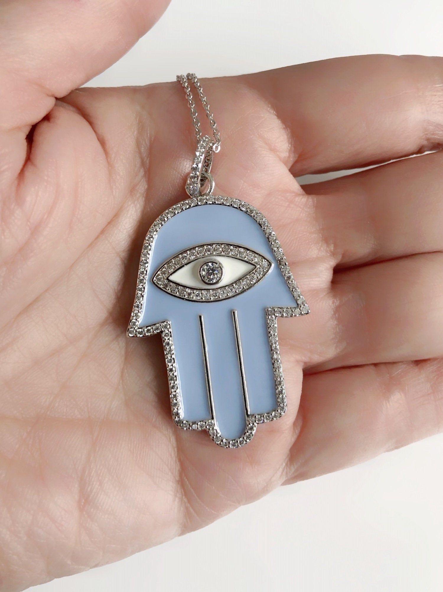 Eye Catching Hand Necklace