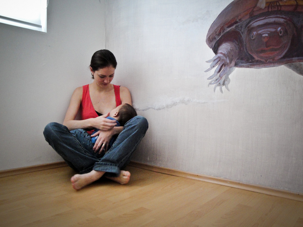 Mother breastfeeding baby yoga studio