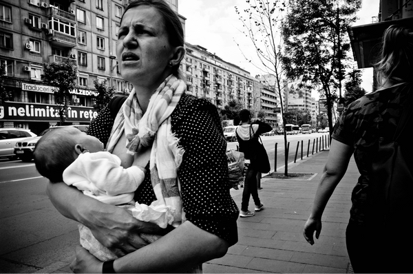 Mother walking while breastfeeding in Europe