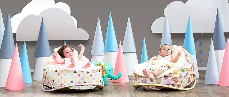two babies in snuggle pod baby bean bags by chibebe
