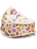 Baby in Chirpy baby bean bag and pod rocker by Chibebe