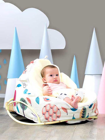 Baby on Snuggle Pod baby bean bag resting on Pod Rocker