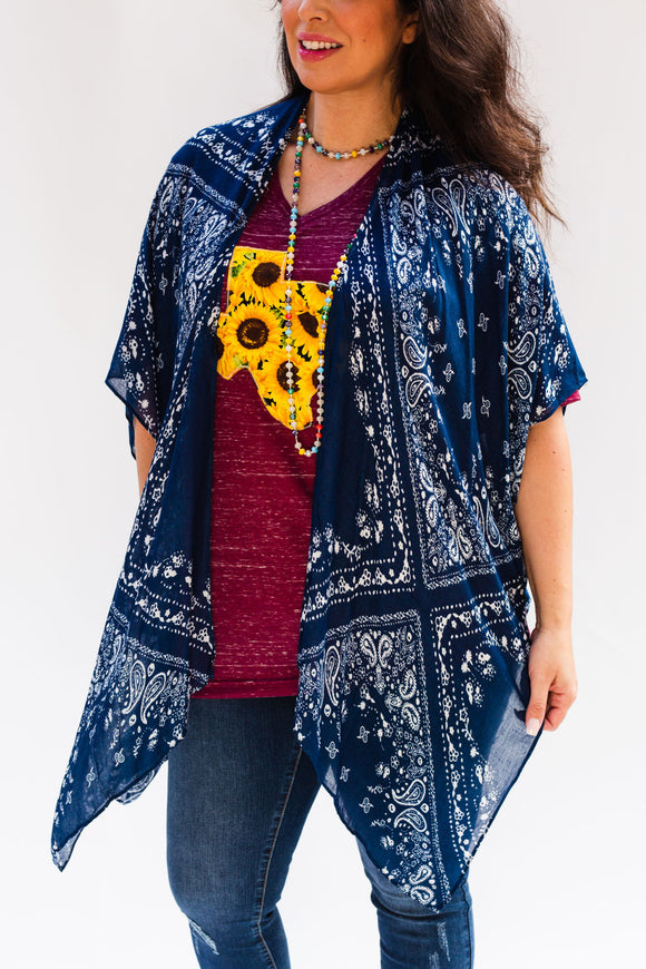 It looks like a classic paisley bandana, but is actually a kimono cover up!  Style Suggestion: Perfect for pairing with your favorite STT Custom Tee or a graphic tee.  Size Suggestion: One size fits most, fits sizes Small- XL
