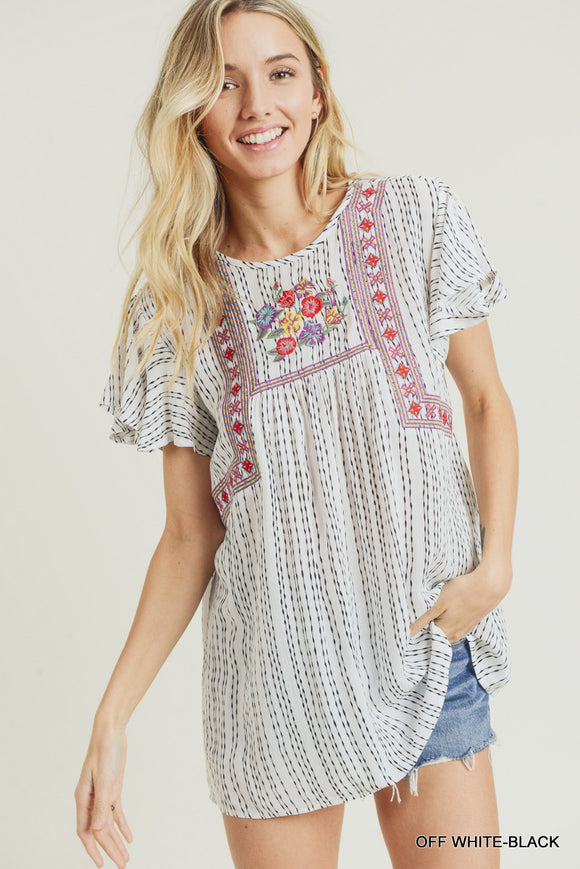 A super colorful embroidery detail across the yoke, featured on a lightweight striped gauzy material, makes this top perfect for spring, summer, and will last until fall.  Style Suggestion: Pair this top with a front tuck into your favorite bell bottom jeans or distressed denim and some suede booties.  Size Suggestion: Small (2-4), Medium (6-8), Large (10-12)