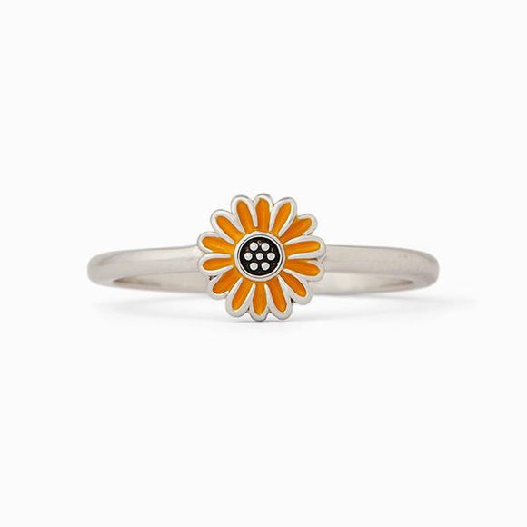 Everyone loves fresh flowers, but this Sunflower Ring is sooo much better. Set on a silver-plated band, this low-profile style features an enameled sunflower charm that's perfect for stacking (and practically screams spring!).