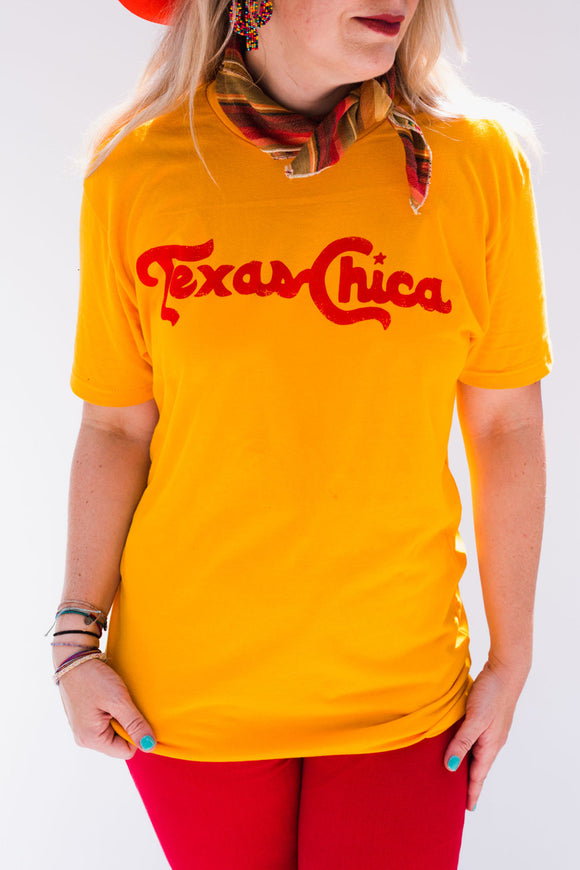 Made in the original Topo Chico font, our photo was also featured on Topo Chico's Instagram! Style Suggestion: The most vibrant Gold color, the perfect tee for representing the Best State in the country! Size Suggestion: Standard Unisex Sizing  Tiphane is a 0/2 and is wearing the Small.