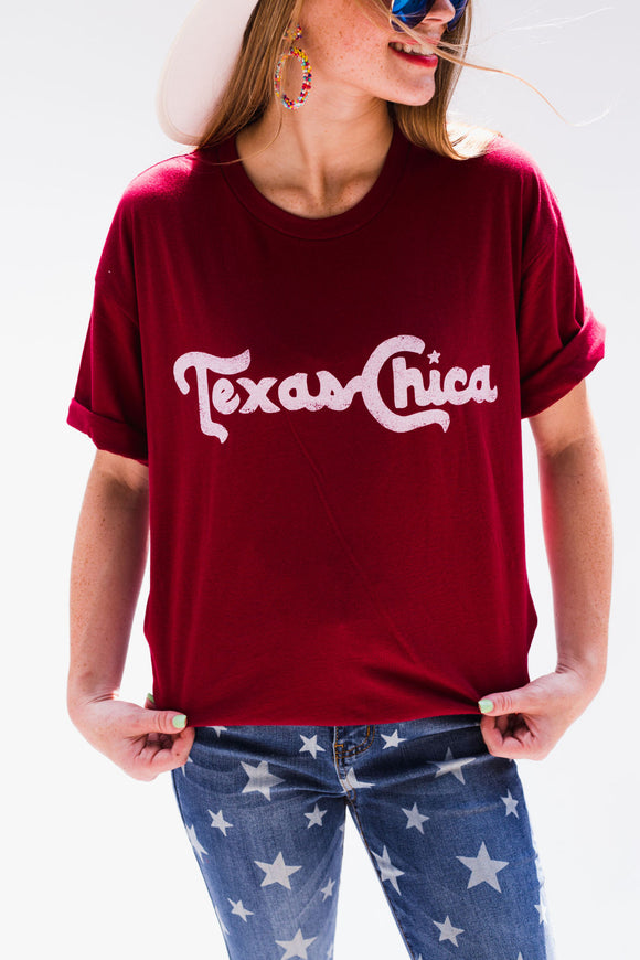Let everyone know you are not ashamed to be a gal from the Lone Star State with this Texas Chica T-shirt! Screenprinted in the Topo Chico font. Style Suggestion: Pair this graphic tee with white skinny jeans and a cardigan for a great casual look. Size Suggestion: Standard Unisex Sizing