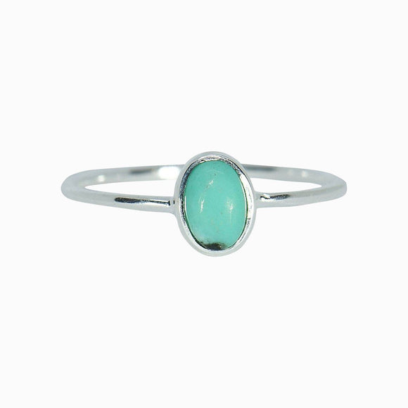 This one-of-a-kind Oval Turquoise Ring is practically made for your spring and summer stacks. It's set on a simple sterling silver band and each turquoise stone is 100% genuine, so no two look alike (meaning every piece is unique—just like you!).