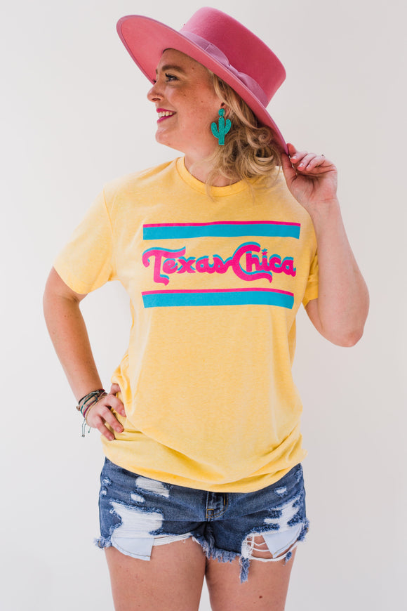 Style Suggestion: A classic take on our number one tee! The perfect blue and pink on a banana cream tee, a must have for summer.   Screenprinted on a unisex sized tee