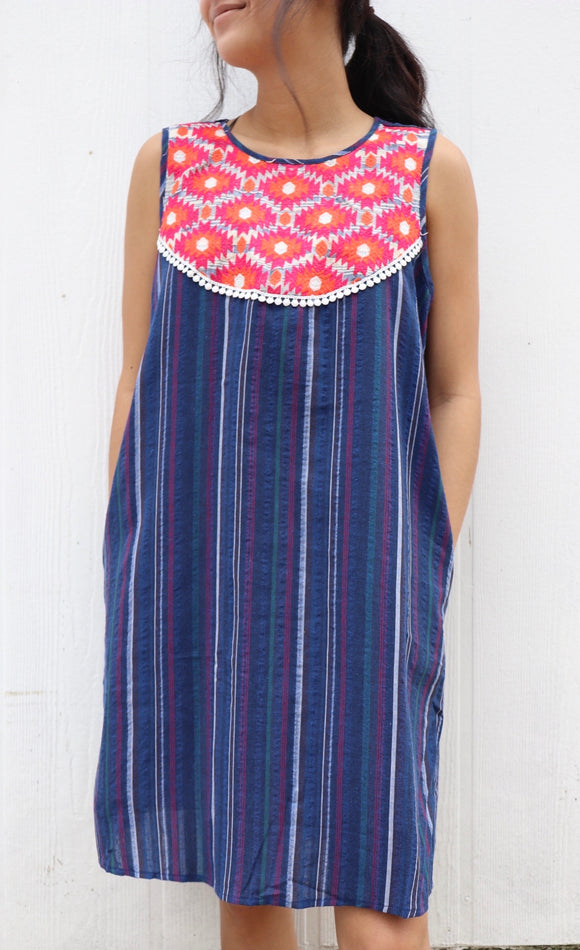 With the perfect vertical stripes and embroidered yoke, this dress is perfect for every day wear or your Sunday best. Best Feature: Colorful embroidery and it has POCKETS! Size Suggestion: Small (2/4) Medium (6/8) Large (10/12)