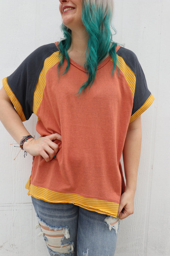 This casual top is loose fitting and comfy! We love the high low side slits.