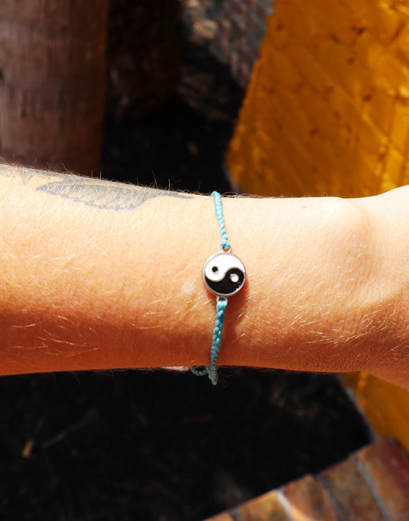 Achieve inner balance with this enamel Yin Yang bracelet. Don't forget the earrings that match!