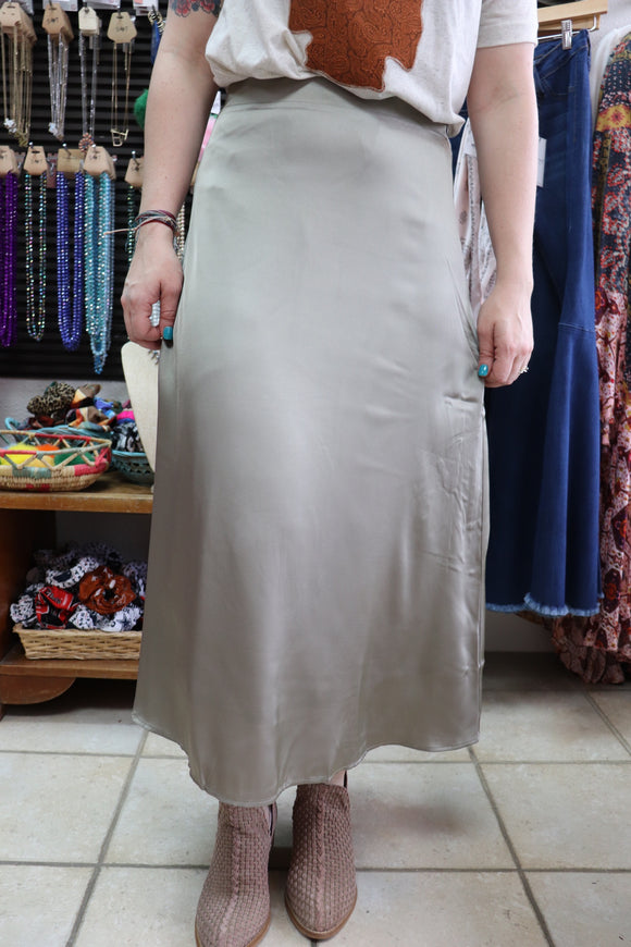 Our favorite statement piece fit for all seasons! This silky midi- skirt is fully lined, complete with a size zipper, and comes in 3 colors [Red, Smoke Green, Terracotta]! Style Suggestion: Pair with your favorite graphic tee or STT Custom Tee and some slip on sneakers for an easy and effortless outfit for summer. Size Suggestion: Small (2-4), Medium (6-8), Large (10-12)
