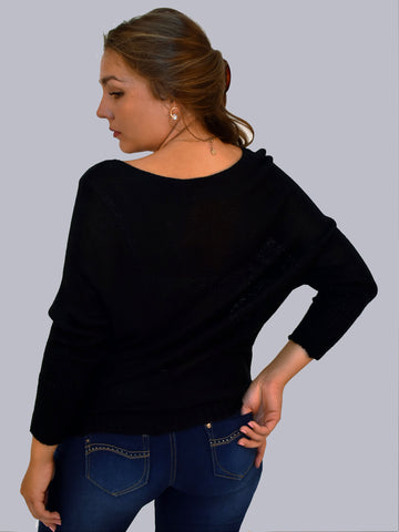 A back picture of our model in our all occasion plain black jumper with a slash neck style.