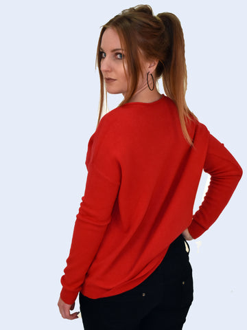 back image of Red long sleeve jumper with self patterned star