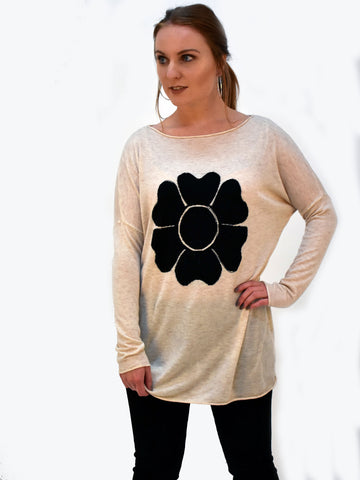 A front on picture of our Ivory Long sleeve jumper with a black flower with diamante in the flower.