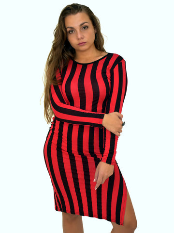 A picture of our model wearing our celebrity inspired balck and red vertical stripe midi dress with a small slit on the right hand side.