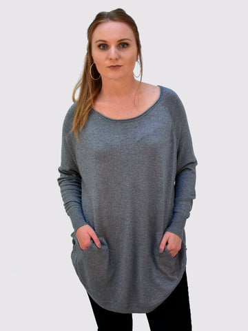 A front on picture of our Grey metallic jumper which is long sleeved and has pockets.