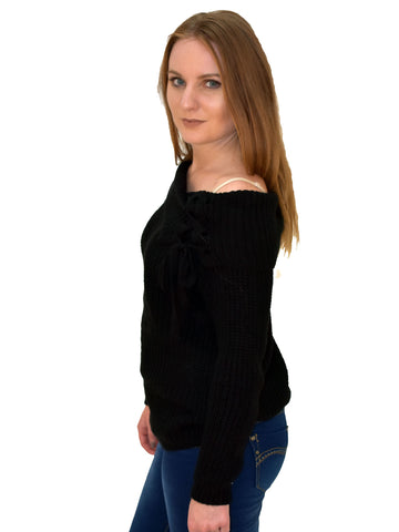 Side image of black chunky knit long sleeve jumper with lace up neck detail