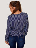 A back picture of our model wearing a crossover navy blouse long sleeve with a white pinstripe. Our model is 5ft 5 inches tall and wears an uk size 8 to 10.