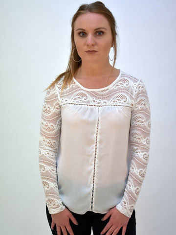 A picture of our Ivory lace long sleeve blouse. The lace detailing is also at the top of the blouse