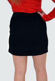 back image of black denim mini skirt with button through front