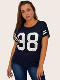 A picture of our navy print tshirt that has 98 on the front. our model is 5ft 5 inches tall and wears an uk size 8 or 10.